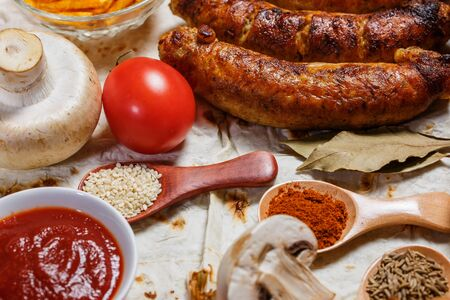 Fried sausages, vegetables, hot peppers and various spices and ingredients on pita bread Archivio Fotografico