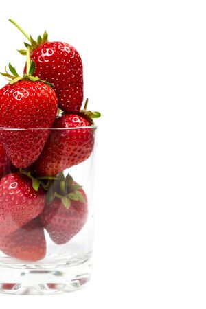 Ripe strawberries on a white background, close