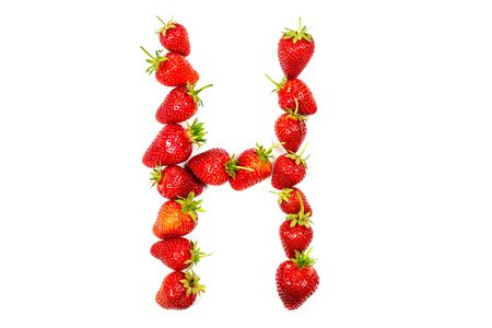 Letter H made from ripe strawberries on a white background