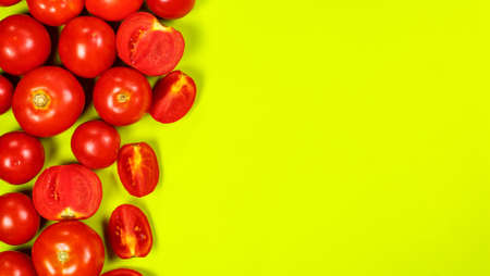 Ripe red tomatoes for salad on a green background