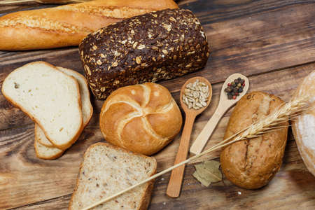 Sliced fresh gluten-free bread on wooden surface