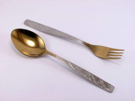 parallelism: fork and spoon on white background                                Stock Photo
