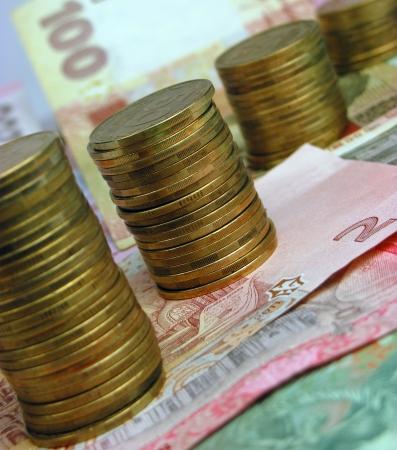 remuneraci�n: Los billetes y monedas Foto de archivo
