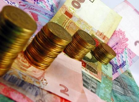 remuneraci�n: A pilas de monedas y billetes