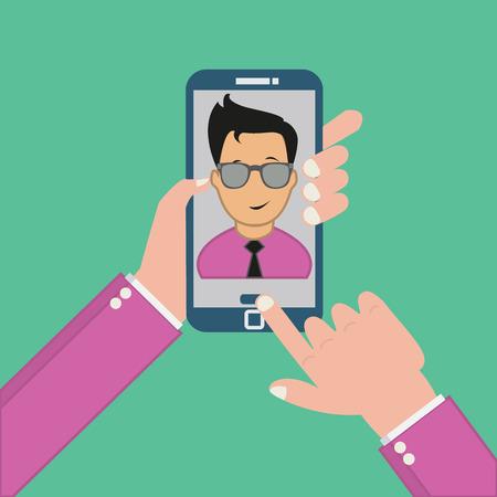 緑の背景にスマート フォンのコンセプトで Selfie 写真を取っています。