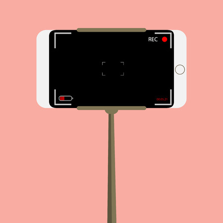 video: handle video. phone video camera. device for video on a pink background