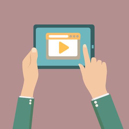 画面にビデオ プレーヤー、タブレット コンピューターを保持している人間の手