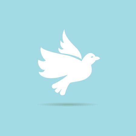 青色の背景に飛んでいる鳩