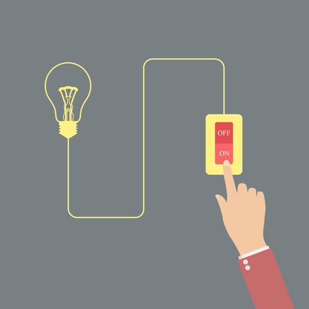 明るい電球のボタンを押す手で表すアイデアをオンに