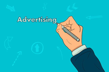 The hand of a businessman writes the word Advertising