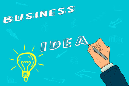 The hand of a businessman writes a business idea