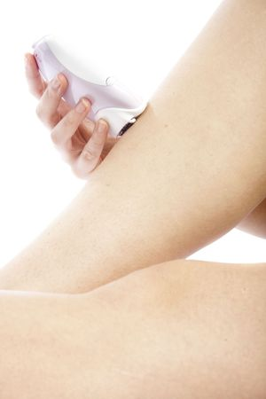 Woman doing epilation on her leg with electric epilator Stock Photo - 6543398