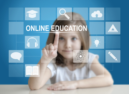Little student girl choosing icon on virtual touch screen. Baby using a touch screen interface. Digital learning. E-learning Education Internet Technology Webinar Online Courses concept