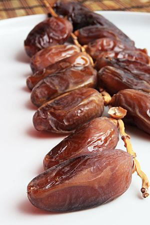 dates on a white plate Stock Photo