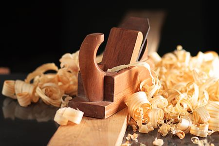 whittle: Old wooden plane and shaving