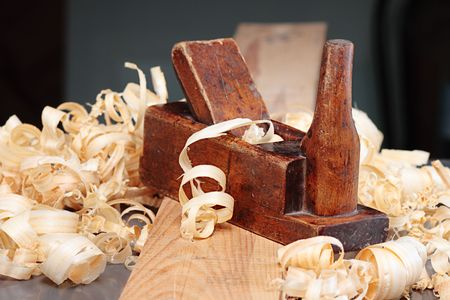whittle: Old wooden plane and shaving,shallow DOF Stock Photo