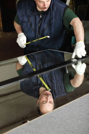 The worker, cutting a mirror photo