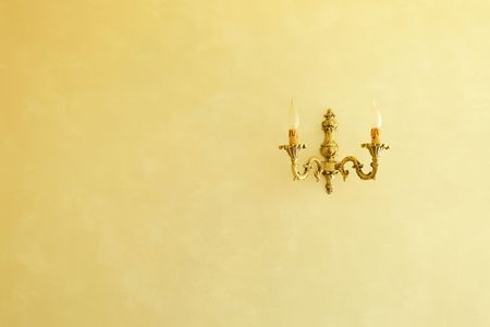 sconce: bronze sconce on a yellow wall