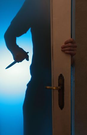 silhouette of the criminal with a knife photo