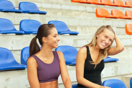 tribune: Two girls after training on a tribune Stock Photo