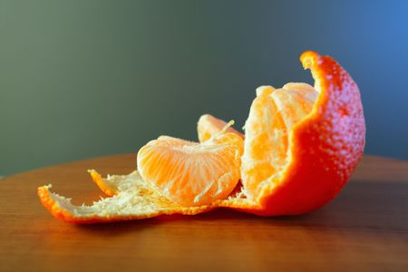 sours: ripe tangerine on a wooden table,shallow DOF