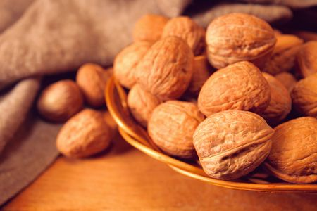walnuts in basket,focus on a foreground Stock Photo - 6522641