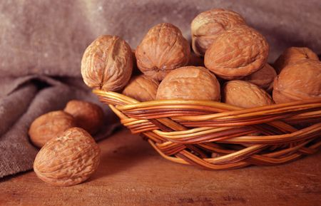 walnuts in basket,focus on a foreground photo