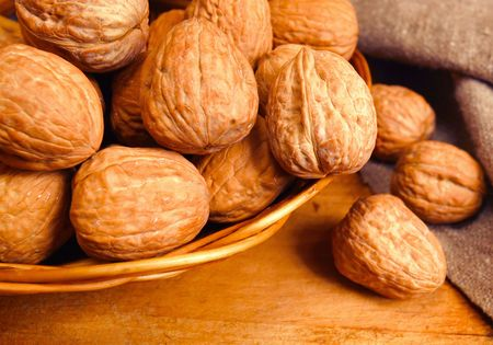 walnuts in basket,focus on a foreground Stock Photo - 6611668