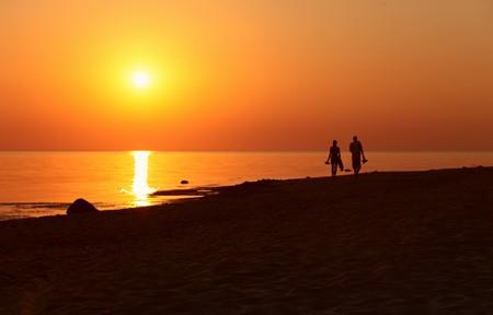 sunset on a sea beach Stock Photo