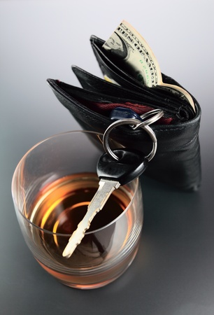 Whisky,money and key from car. Stock Photo - 8991478