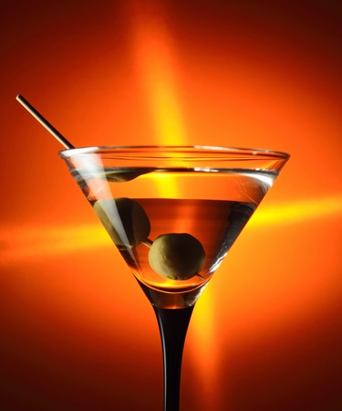 glass with martini and green olives Stock Photo - 9151266