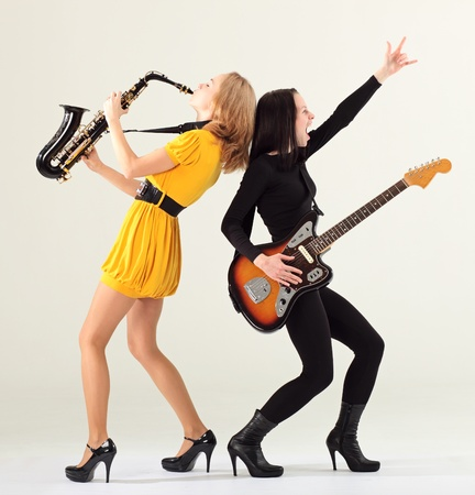Two girls with musical instruments. photo