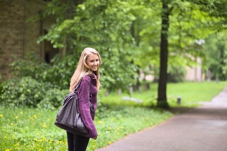 The young smiling woman in park. photo