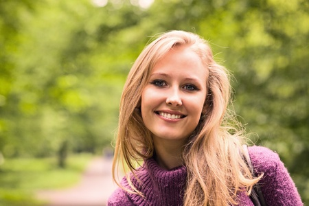 The young smiling woman in park. Stock Photo - 9639561