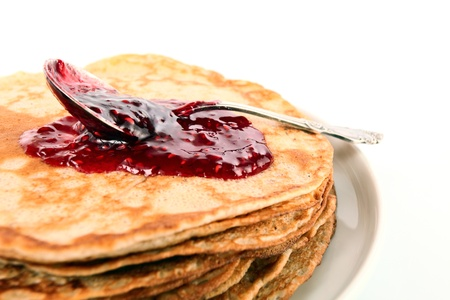 pancakes ,raspberry confiture and silver spoon.  photo