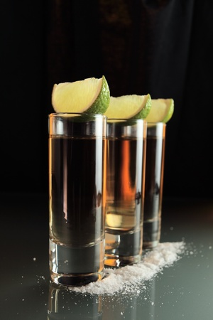 tequila: tequila and lime on a glass table. Stock Photo