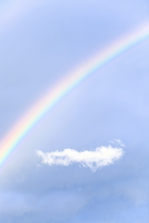 rainbow and small white cloud. photo