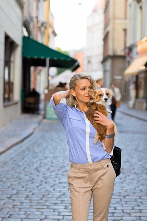 young woman with chihuahua in old city. photo