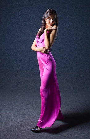 evening gown: young woman in pink evening dress, professional make-up. Stock Photo