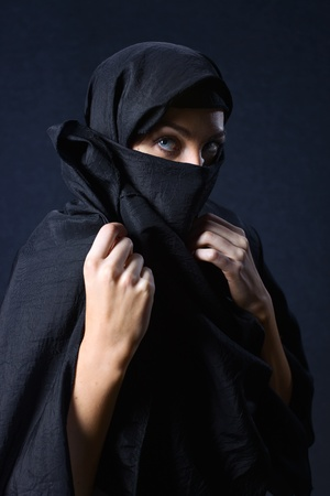 face covered: The  woman in a black coverlet. Stock Photo