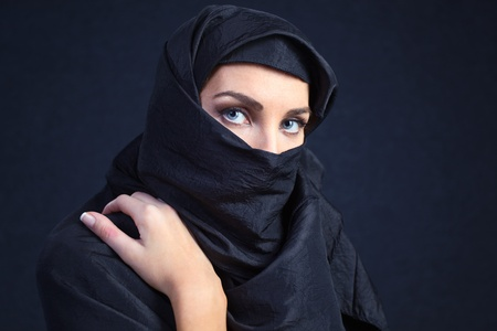 mystery woman: The  woman in a black coverlet. Stock Photo