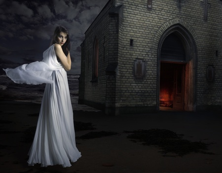 fantasy girl:  woman in white dress before a church