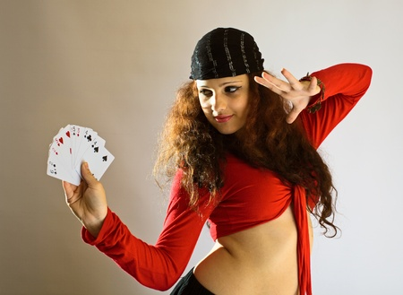 tell fortune: The young beautiful gipsy girl predicts the future on cards.