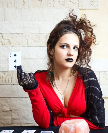 The young beautiful gipsy girl predicts the future on cards. Stock Photo - 10943790