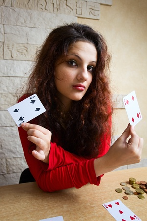 The young beautiful gipsy girl predicts the future on cards. Stock Photo - 10943793