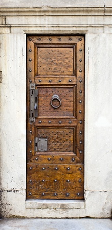 Fragment of cathedral, wooden door, Gothic style, Florence. photo