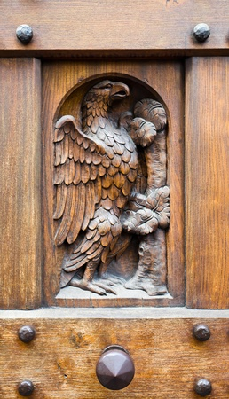 Fragment of a wooden door, Gothic style, Florence. photo