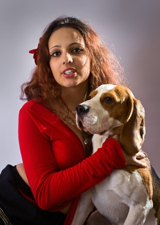 The young beautiful gipsy girl with beagle. Stock Photo - 11216332