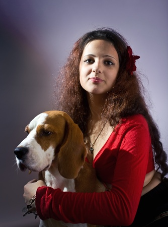 The young beautiful gipsy girl with beagle. Stock Photo - 11216310