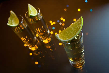 tequila and lime on a glass table. photo